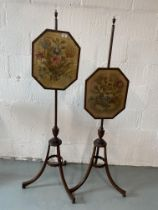 Two Regency tripod pole screens, each with a needlepoint silk floral spray panel, the boxwood strung