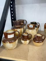 A quantity of Doulton Lambeth ware jugs/pitchers/vessels in various sizes including ; Queen Victoria