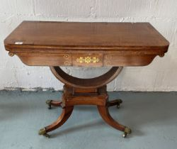 A Regency rosewood and satinwood banded folding card table with brass inlaid detailing c.1810,