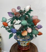 Chinese cloisonne planter containing ornamental tree with a mixture of semi precious stones of