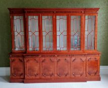A Chippendale-style breakfront mahogany six-door bookcase with astragal front, blind carving to