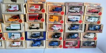 A collection of 95 Lledo Promotional, Commemorative and Souvenir vans, most with boxes, some with