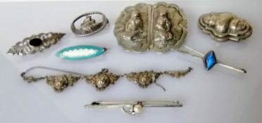 A selection of seven silver based brooches, one necklace and two others
