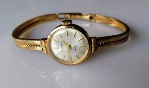 A Garrard mid-century ladies 9ct gold presentation watch with baton numerals, in working order,