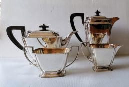 An Art Deco silver four-piece tea/coffee service with stylized design, reeded handles on stepped