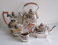 An Art Deco silver plated five piece tea/coffee service including a tea kettle by Roberts & Belk,