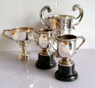 An Edwardian silver two-handled trophy cup on a stepped base by Mappin & Webb, London, 1905, 14 h