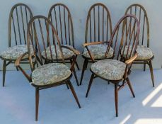 A set of six (4+2) Ercol blue label elm and beech spindle-back Quaker Windsor dining chairs,