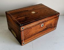 A 19th century rosewood writing slope with mother of pearl string inlay, recessed brass handles,