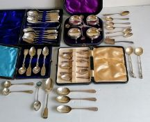 A cased Victorian set of four silver salts with beaded rims, hoof feet and conforming spoons by