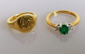 An oval emerald (6mm x 4mm) and diamond ring on yellow gold with an initialled signet gold ring,
