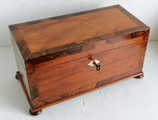 A Georgian mahogany and rosewood crossbanded tea caddy with ivory escutcheon, fitted interior with