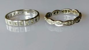 A white gold eternity ring, size P, hallmarked 750, 2.95g and another, size Q, hallmarked 585, 2.5g,
