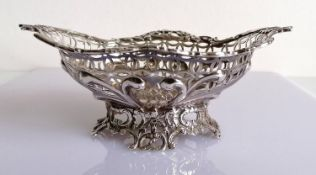 An oval Victorian pierced silver basket with C-scroll decoration by William Comyns, London, 1890,