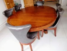A Henredon for Ralph Lauren Polo oval extending dining table, plain frieze, one extra leaf on a