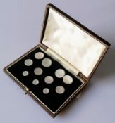 A cased mother of pearl and gold dress set comprising: a pair of double sided cufflinks, four