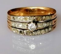 An Art Deco diamond and gold ring with triple-split shank, pave-setting with old-cut and central