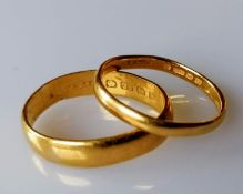 Two 22ct gold wedding bands, 5mm, 2mm, both size O and hallmarked, 6.89g