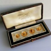 A cased set of gold shirt buttons, stamped 9ct, 3.14g