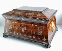 A Regency rosewood sarcophagus tea caddy converted to a jewellery box with mother of pearl inlay