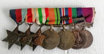 A group of seven medals awarded to No. 7587625 W. O. CL. 1 E. FORDRED. R. A. O. C.:- 1939/45 star,