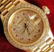 A Rolex ladies 18K gold diamond and ruby-set automatic wristwatch, with centre sweep seconds hand,