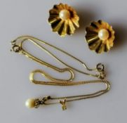 A pair of mid-century gold shell clip-on earrings with pearl decoration and a chain with two small