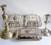 A pair of Victorian silver plated entree dishes with rococo decoration, (both with twist on