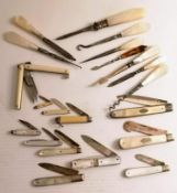 An assortment of eleven Edwardian mother-of-pearl and ivory-handle pen knives, some with