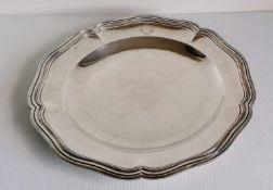 A late 19th century French circular silver platter with reeded border, hallmarked for Eugene