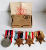 A WW2 medal group and three other medals without ribbons