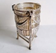 A Victorian silver pierced circular basket with swag and rams head decoration on hoof feet by George