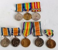 An assortment of WW1 medals, mostly individual