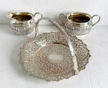 A colonial Indian silver two-handled sugar bowl, matching cream jug and tongs stamped silver and a