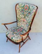 An Ercol beechwood Windsor stick-back armchair with swept arms, loose cushions, splay legs and