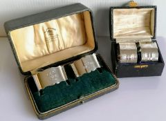A pair of George V cased silver napkin rings with serrated edges by Samuel Walton Smith,