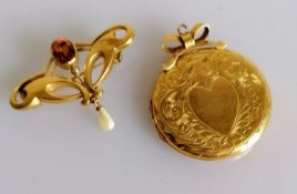 An Art Nouveau citrine and pearl brooch with an etched pendant locket, both on 9ct yellow gold and