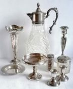 An assortment of late Victorian and Edwardian silver to include a pair of dwarf candlesticks,