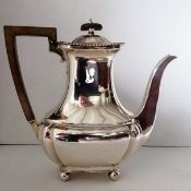 An Edwardian silver coffee jug with fruitwood handle, gadroon rim on ball feet by John Round & Son