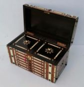A 19th century ivory bound tea caddy with lidded interior, foil-lined compartments with key, 15 h