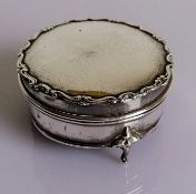 A George V silver trinket box with hinged lid and lined interior on three cabriole legs by Robert