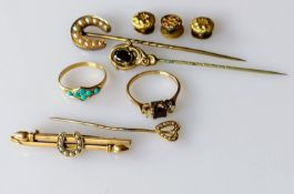 An Edwardian seed pearl horseshoe brooch, stamped 15ct, 2.4g; a similar pin brooch, a garnet set