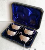 A Victorian cased set of four silver salts with half-fluted decoration, twin handles by James