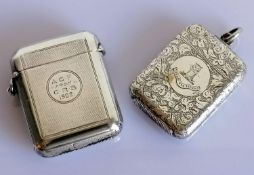 A late Victorian silver vesta case with engine turned decoration and dedication, another with