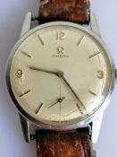 A 1960's men's Omega manual wristwatch with baton and Arabic numeral markers, subsidiary seconds