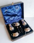 An Edwardian cased silver condiment set comprising two salts, mustard, salt, pepper with three