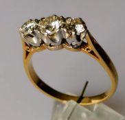 A three-stone diamond ring, the brilliant-cut graduated diamonds measuring 0.50, 0.25 (x2) carats,