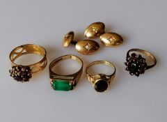 Four gem-set 9ct gold rings, various sizes and a pair of cufflinks with seed pearl decoration (one
