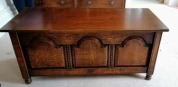 A Harrods Royal Oak Furniture blanket chest with hinged lid, arcaded front on turned feet, 53 h x