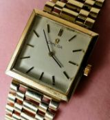 A mid-20th century Omega manual men's wristwatch with 9ct yellow gold bracelet strap, square dial,